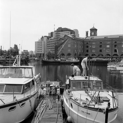 A young couple on their boat in St. Katharine's Dock; 1975