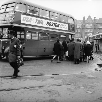 Commuters boarding a bus in Golders Green; c1960