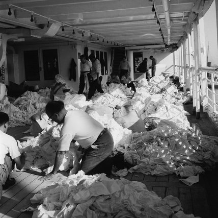 Sorting linen imported from Hong Kong in London's Docks; 1959