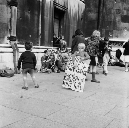 Child protester with billboard highlighting evictions at the Kings Hill hostel; 1966