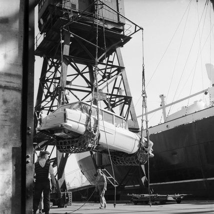 Loading Victor cars for shipping to the United States from King George V Dock