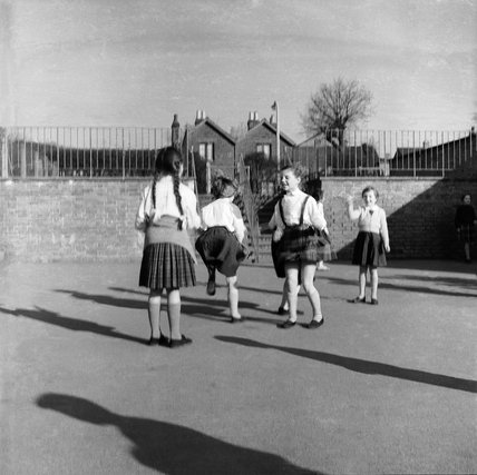 Children in the playground at Courtland Primary School in Barnet; 1961