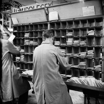 Employees at work sorting letters at the Royal Mail Mount Pleasant Sorting Office; c 1965