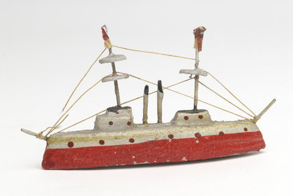 Toy battleship of plaster; 1914
