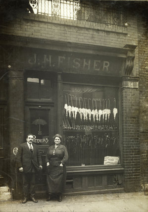 J.H. & M. Fischer outside their umbrella shop; 1919
