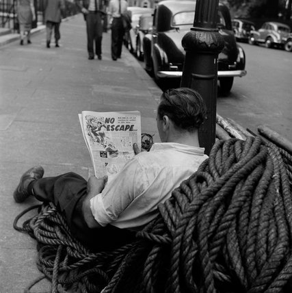 Man reading the paper; 1955