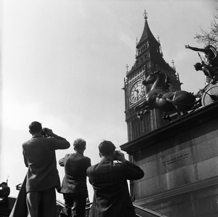 Tourists photographing Big Ben; c.1951