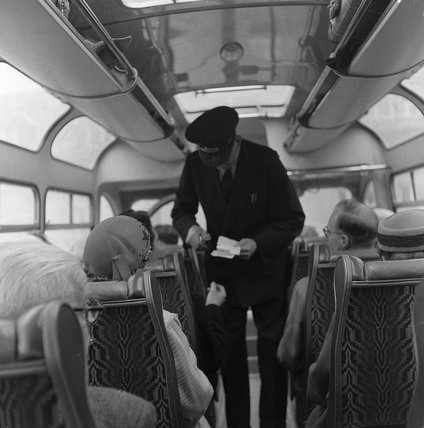 A ticket inspector checking tickets; 1958