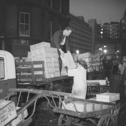 Unloading boxes of fish at Billingsgate Market: 1958
