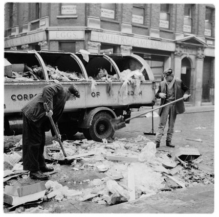 Sweeping streets outside Billingsgate Market: 1958