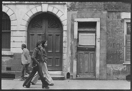 Men walking down the street in Spitalfields; 1978