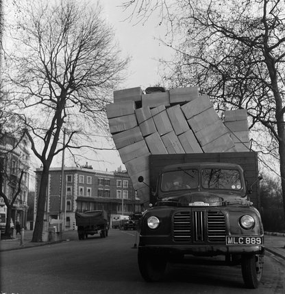 Lorry loosing its load; 1951