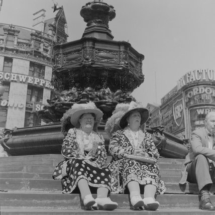 Pearly Queens on the steps of Eros; c.1960