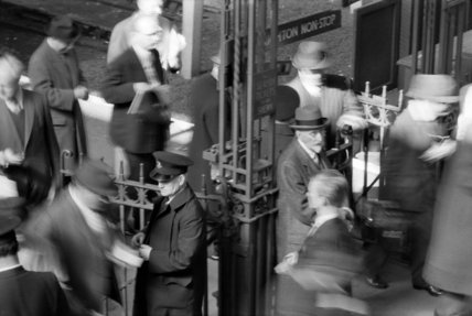 Ticket barrier at rush hour on Victoria Station; c.1960
