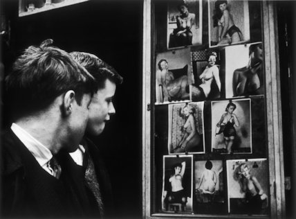 Two boys gazing at images of semi-nude women: 1961