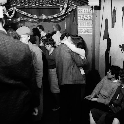 A couple kissing at a party c.1955