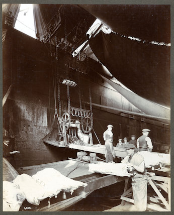 Porters unloading meat from a ship c.1920