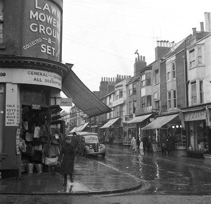 Shoppers on a high street. c.1955