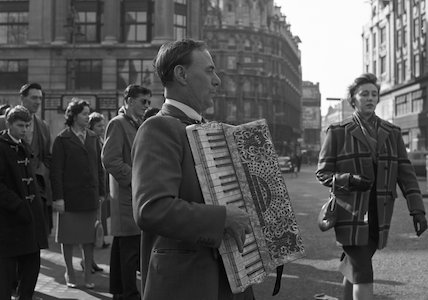 Man plays the accordion. c.1955