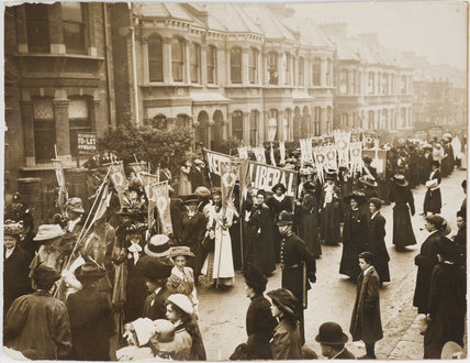 Suffragette procession' forming up' in a residential street duri