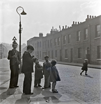 Children standing on a London Street; c. 1960