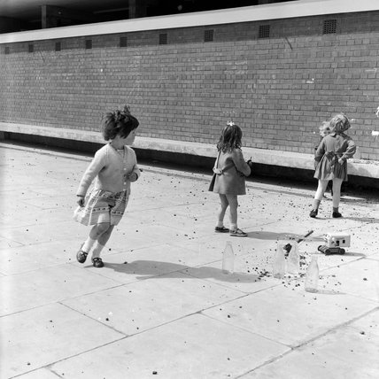 Children playing in the street. 1962