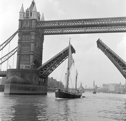 Tower Bridge open to allow the 'Sir Alan Herbert' to sail throug