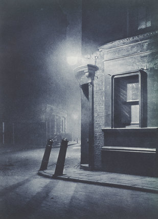 Atmospheric night photograph of a back street in London; 1934