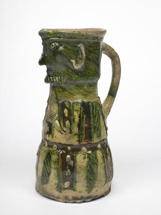 Green glazed ceramic jug: 14th century