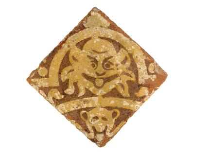 Square terracota tile with gargoyle design: 14th century