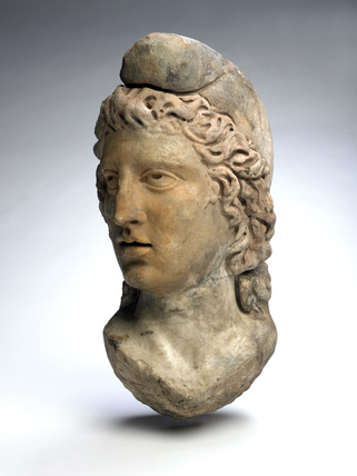 Statue head of God Mithras: 2nd-3rd century