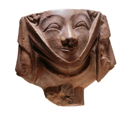 Medieval corbel in the shape a woman's head