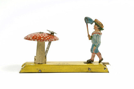 Mechanical penny toy of boy with butterfly net: 20th century