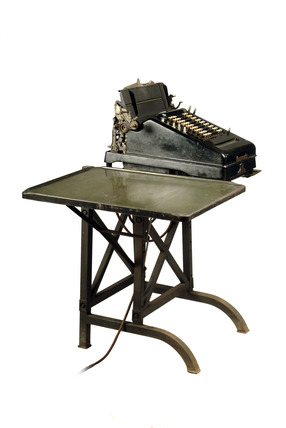 Calculating machine on stand: 20th century
