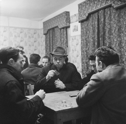 Men play cards in an Italian cafe and bar, Soho: 20th century