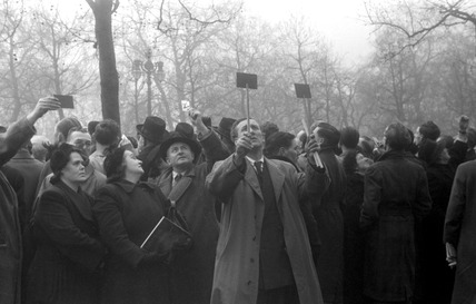 Onlookers view the funeral procession of King George VI: 1952