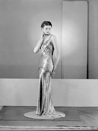 Image of a woman modeling eveningwear: 1934