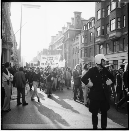 Protesters march down a London street: 1973