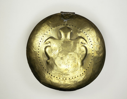 Lid of a brass bed-warming pan: 17th century