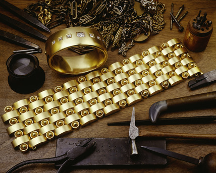 Gold bangle and bracelet with jeweller's tools: 19th century