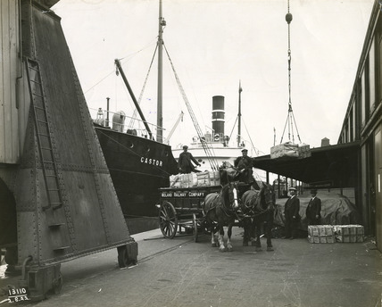 Unloading paper at Surrey Commercial Docks: 1922
