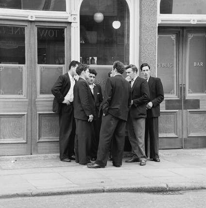 A group of boys in 'Teddy Boy' dress outside a London pub: 1960