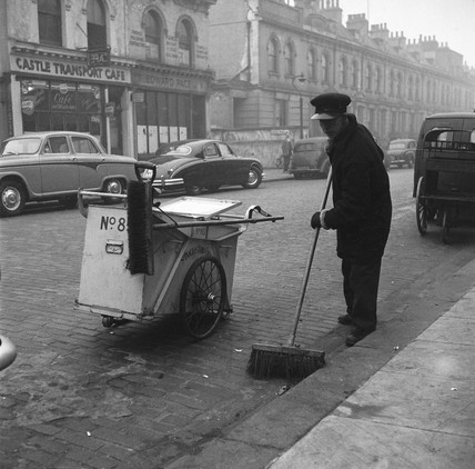 A roadsweeper at work: 1959