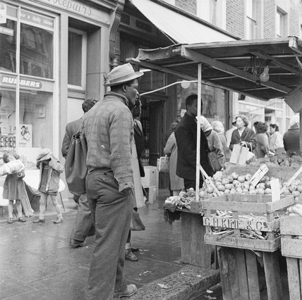 A man at a fresh produce stall, Kensington: 1961
