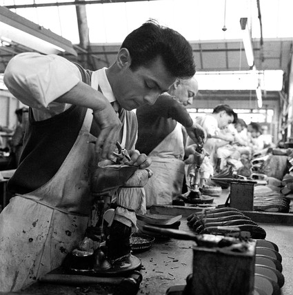 A Gamba employee pleats the upper of a ballet shoe: 1966