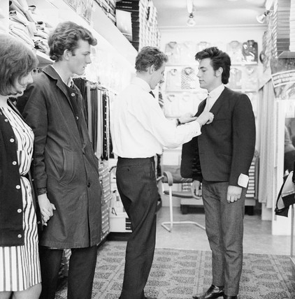 Members of The Southbeats band shop for clothing: 20th century
