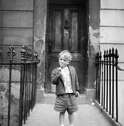 Boy on steps, Maida Vale: 1960