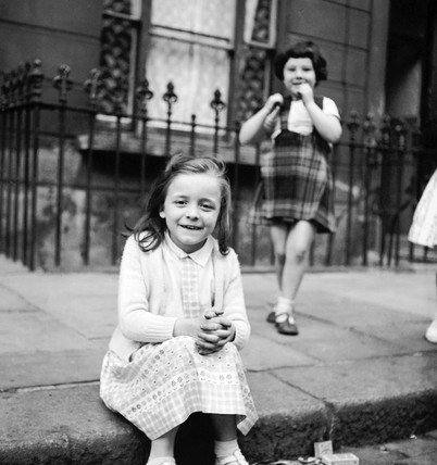 Two small girls in the street, Maida Vale: 1960