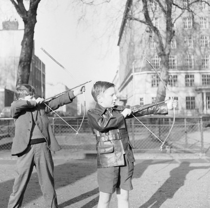 Boys with bows and arrows in Russell Square: 1957