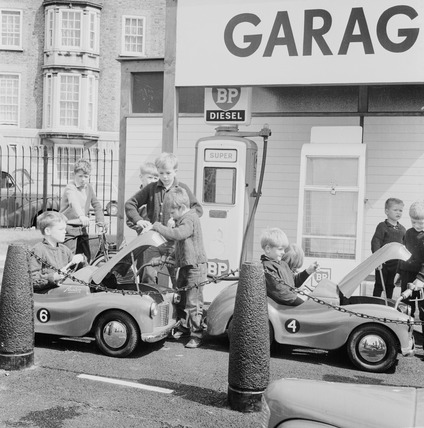 Children playing at miniature petrol station: 1965